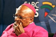 South Africa's Archbishop Desmond Tutu pauses for a moment during a media briefing on December 6, 2013 in Cape Town
