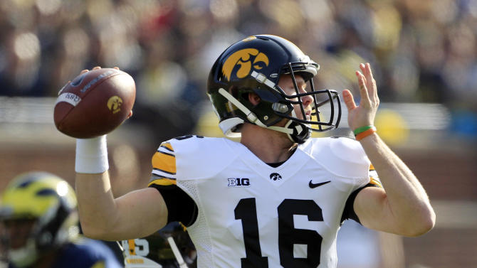 Iowa  quarterback James Vandenberg (16) throws during the first quarter of an NCAA college football game against Michigan at Michigan Stadium in Ann Arbor, Mich., Saturday, Nov. 17, 2012. (AP Photo/Carlos Osorio)