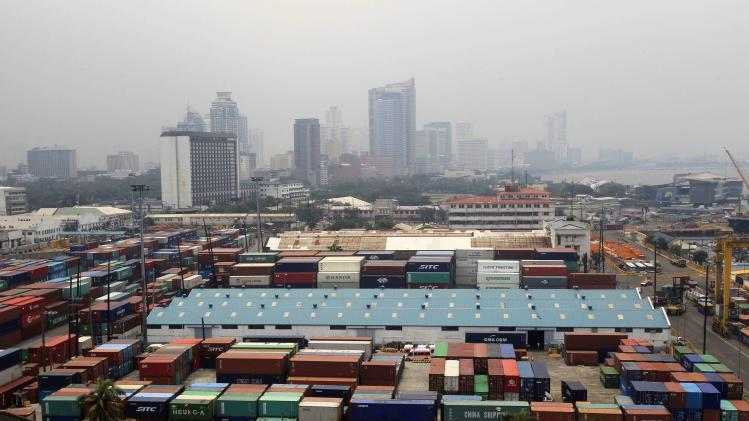 Containers are seen after they were unloaded from a cargo vessel, at the port in Manila