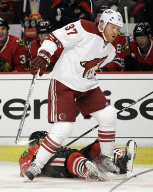 Chicago Blackhawks' Marian Hossa (81) of Russia, falls down after hit from Phoenix Coyotes' Raffi Torres (37) during the first period of Game 3 of an NHL hockey Stanley Cup first-round playoff series in Chicago, Tuesday, April 17, 2012. (AP Photo/Nam Y. Huh)