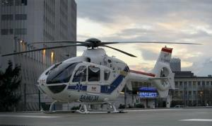 An helicopter stands outside the CHU Nord hospital in Grenoble, French Alps, where retired seven-times Formula One world champion Michael Schumacher is reported to be hospitalized after a ski accident