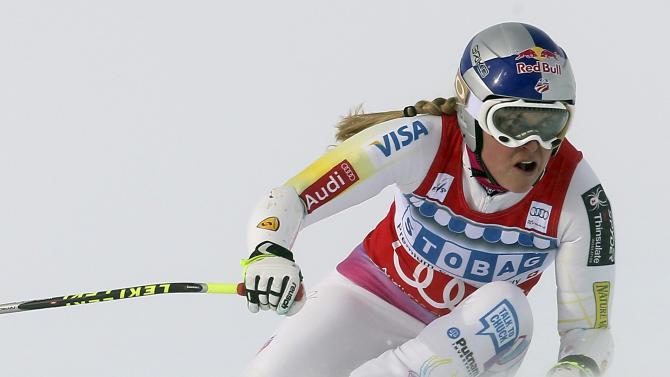 Lindsey Vonn, of the United States, speeds down the course on her way to win an alpine ski, women's World Cup super-G, in St. Moritz, Switzerland, Saturday, Dec .8, 2012. (AP Photo/Marco Trovati)