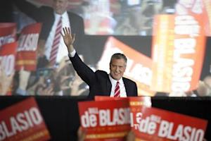 Liberal Democrat Bill de Blasio gestures as he walks onstage during his election victory party at the Park Slope Armory in New York