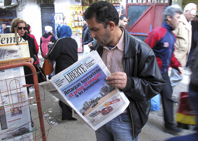 "A man reads a newspaper headlining ""Terrorist attack and kidnapping in In Amenas"", at a news stand in Algiers, Thursday, Jan. 17, 2013. Algerian forces raided a remote Sahara gas plant on Thursday in"