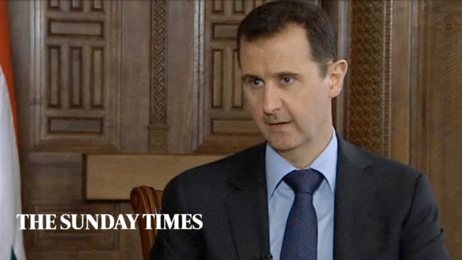 "In this image taken from video filmed on Thursday, Feb. 28, 2013 and released Saturday evening, March 2, 2013, Syrian President Bashar Assad speaks during an interview with the Sunday Times, in Damascus, Syria. Iran and Syria condemned a U.S. plan to assist rebels fighting to topple Assad on Saturday and signaled the Syrian leader intends to stay in power at least until 2014 presidential elections. Assad told the Sunday Times in the interview timed to coincide with U.S. Secretary of State John Kerry's first foreign trip that ""the intelligence, communication and financial assistance being provided is very lethal."" Kerry announced on Thursday that the Obama administration was giving an additional $60 million in assistance to Syria's political opposition and would, for the first time, provide non-lethal aid directly to the rebels.  (AP Photo/Sunday Times via AP video) THIS IMAGE IS FOR USE FOR 24 HOUR NEWS ACCESS ONLY, SUNDAY TIMES LOGO MUST NOT BE OBSCURED, NO ARCHIVES, NO SALES /PLEASE CONTACT SUNDAY TIMES SYNDICATION DEPARTMENT BY EMAIL TO ENQUIRIES@NISYNDICATION.COM FOR QUESTIONS REGARDING USE OUTSIDE THE 24 HOUR NEWS ACCESS WINDOW"