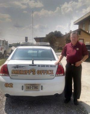 Lee County, Va., Sheriff Gary Parsons stands next to…