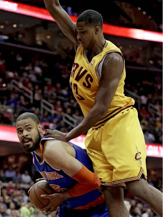 New York Knicks' Tyson Chandler, bottom, looks for help under pressure from Cleveland Cavaliers' Tristan Thompson during the first quarter of an NBA basketball game, Monday, March 4, 2013, in Clevelan