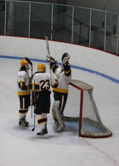 Bloomington Kennedy goalie David Johnson celebrates his goal with teammates — Bonnie Foley photo