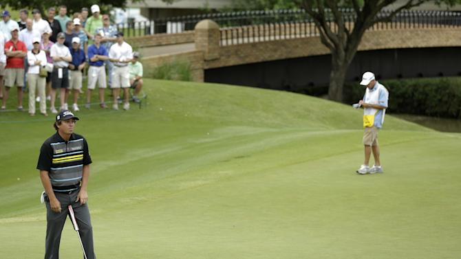 Jason Dufner reacts to missing a putt for birdie on the fifth green during the first round of the Byron Nelson Championship golf tournament Thursday, May 16, 2013, in Irving, Texas. Dufner, who shot even-par on the first day, is the tournament's defending champion. (AP Photo/Tony Gutierrez)
