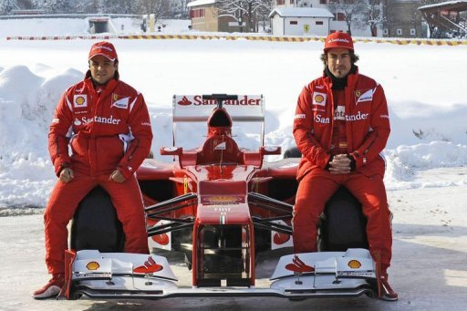 Ferrari drivers Felipe Massa (left) and Fernando Alonso pose with the new F2012 car