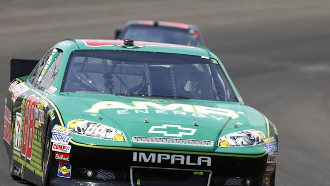 Dale Earnhardt Jr., drives through the first turn during the NASCAR Sprint Cup Series Brickyard 400 auto race at Indianapolis Motor Speedway in Indianapolis, Sunday, July 29, 2012. (AP Photo/Tom Strattman)
