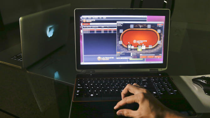 A sample poker game is played on the soon-to-be launched Ultimate Gaming website, Monday, April 29, 2013, in Las Vegas.  The social gaming company is expected to launch the first legal, real-money poker site in the U.S. Tuesday morning. The Ultimate Gaming site will be available only to in players in Nevada, but likely represents the shape of things to come for gamblers across the country.(AP Photo/Julie Jacobson)