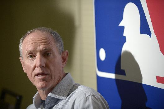 Milwaukee Brewers manager Ron Roenicke answers a question from reporters during a media availability at baseball's winter meetings in Lake Buena Vista, Fla., Tuesday, Dec. 10, 2013
