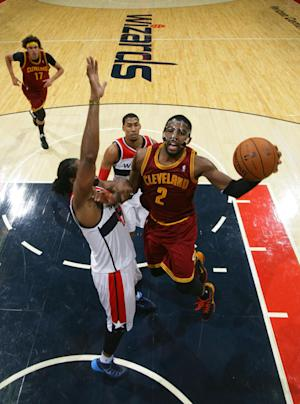 Irving's 41 lead Cavs to 103-96 OT win vs Wizards