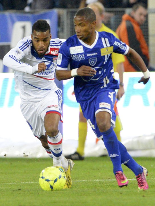 Olympique Lyon's Ghezzal challenges Bastia's Beauvue during their French Ligue 1 soccer match in Bastia