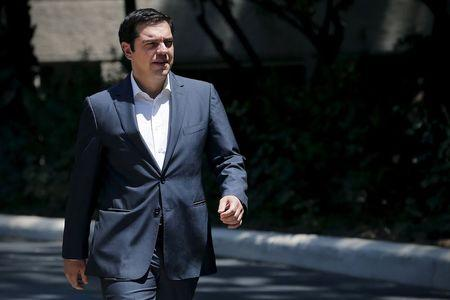 Greek Prime Minister Alexis Tsipras leaves his office at the Maximos Mansion to attend a meal at the Presidential Palace