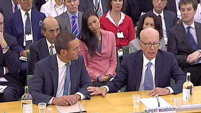 James Murdoch, left, and  Rupert Murdoch, give evidence to the Culture, Media and Sport Select Committee  on the News of the World phone-hacking scandal in this image taken from TV in Portcullis House  in central London Tuesday July 19 2011. (AP Photo/ PA)  UNITED KINGDOM OUT