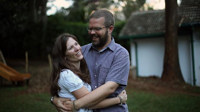 Katherine Walton, 38, from the United States, poses for a photograph with her husband Philip during an interview with the Associated Press in Nairobi, Kenya, Friday Sept. 27, 2013.Walton survived the Westgate Mall attack with her five children and described the moment she nearly came face to face with the attackers as she lay face down (AP Photo/Jerome Delay)