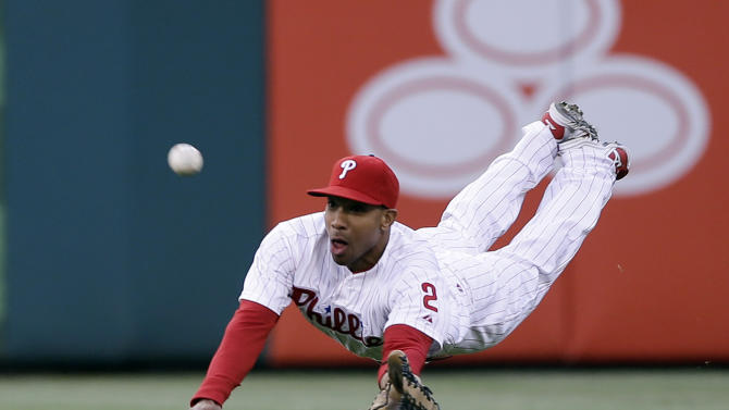 AP10ThingsToSee - Philadelphia Phillies center fielder Ben Revere dives for a fly out by St. Louis Cardinals' Carlos Beltran during the first inning of a baseball game, Saturday, April 20, 2013, in Philadelphia. (AP Photo/Matt Slocum, File)