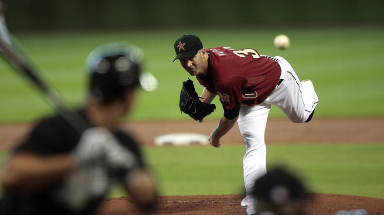 Houston Astros' J.A. Happ throws in the first inning of an MLB baseball game against the Florida Marlins, Sunday, April 10, 2011, in Houston. (AP Photo/Bob Levey)
