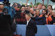 "Japanese film director Takeshi Kitano, seen here arriving for the screening of ""Outrage beyond"" at the 69th Venice Film Festival on September 3, told a group of reporters that the art house cinema in Japan was in ""dire"" straits"