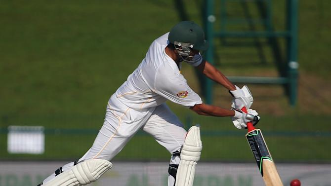 Pakistan's Younis Khan plays a shot during the first day's play of the first cricket Test match between Pakistan and England at The Sheikh Zayed International Cricket Stadium in Abu Dhabi on October 13, 2015