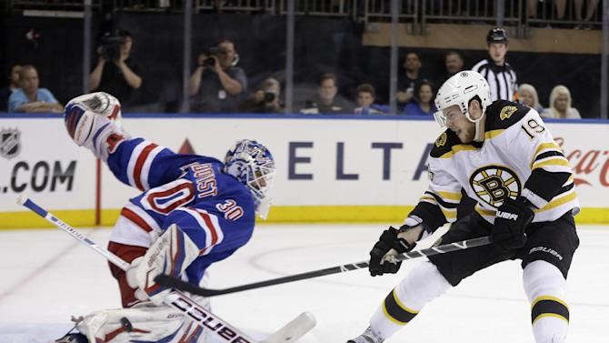 Boston Bruins' Tyler Seguin, right, can't get the puck past New York Rangers goalie Henrik Lundqvist during the first period in Game 3 of the Eastern Conference semifinals in the NHL hockey Stanley Cup playoffs in New York Tuesday, May 21, 2013, in New York. (AP Photo/Seth Wenig)