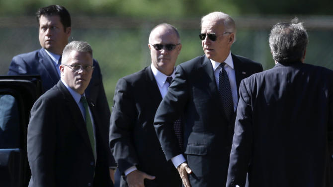 Vice President Joe Biden, second from right, arrives at Har Zion Temple in in Penn Valley, Pa., Tuesday, Oct. 16, 2012, to attend funeral services for former Pennsylvania Sen. Arlen Specter.  Family members say Specter died Sunday of complications from non-Hodgkin lymphoma. He was 82. (AP Photo/Matt Rourke)
