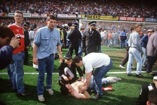 Rescuers help football fans at Hillsborough stadium in Sheffield on April 15, 1989