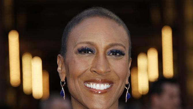 """FILE - In a Sunday Feb. 24, 2013 file photo, broadcaster Robin Roberts arrives at the 85th Academy Awards at the Dolby Theatre, in Los Angeles. Major League Baseball announced Thursday, Feb. 27, 2014 that the """"Good Morning America"""" anchor will speak at the 2014 MLB Beacon Awards Luncheon on May 30 in Houston, before the annual Civil Rights Game. (Photo by Carlo Allegri/Invision/AP, File)"""