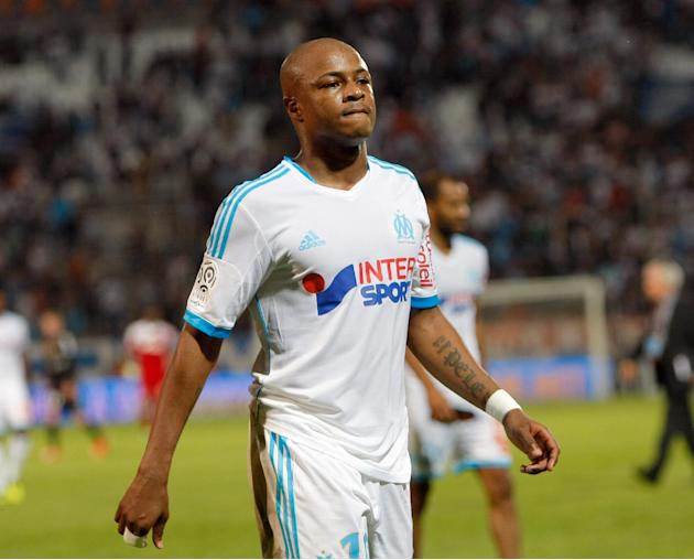 Marseille's forward Andre Ayew reacts after losing against Reims after their League One soccer match, at the Velodrome Stadium, in Marseille, southern France, Saturday, Oct. 26, 2013