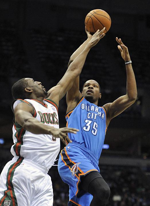 Milwaukee Bucks' Ekpe Udoh left, tries to block the shot of the Oklahoma City Thunder's Kevin Durant (35) during the first half of an NBA basketball game Saturday, Nov. 16, 2013, in Milwaukee