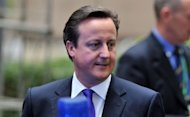 "British Prime Minister David Cameron leaves after a second day of the European Union leaders summit in Brussels. British banks, including HSBC and Barclays, were Friday ordered to compensate businesses for ""serious failings"" over the sale of complex products, capping a scandal-hit week for lenders"