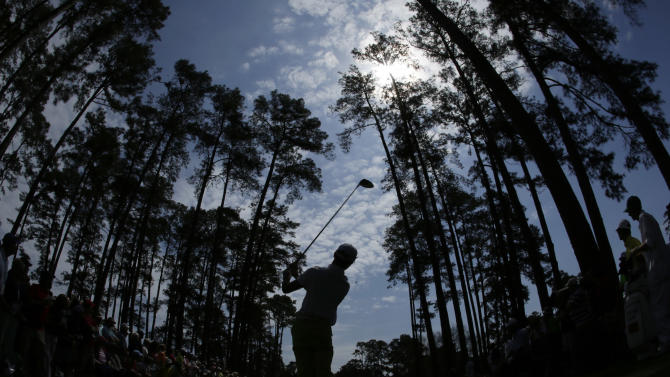 Amateur Guan Tianlang, of China, watches his tee shot on the 17th hole during a practice round for the Masters golf tournament Monday, April 8, 2013, in Augusta, Ga. (AP Photo/Matt Slocum)