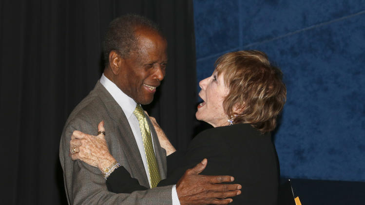 Sidney Poitier and Shirley MacLaine attend the AFI Night at the Movies at the ArcLight on Wednesday, April 24, 2013 in Los Angeles. (Photo by Todd Williamson/Invision/AP)