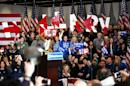 Supporters attend the caucus night event of Democratic presidential candidate former Secretary of State Hillary Clinton in the Olmsted Center at Drake University on February 1, 2016 in Des Moines, Iowa