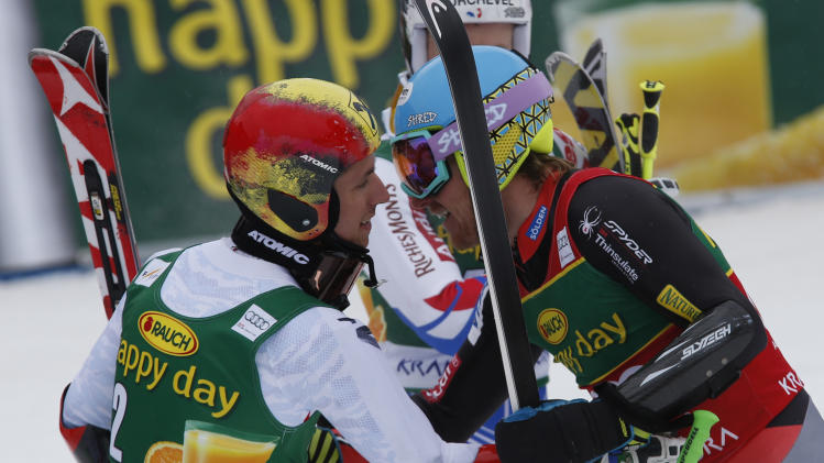 Ted Ligety, of the United States, right, congratulates second placed Austria's Marcel Hirscher after winning an alpine ski, men's World Cup giant slalom, in Kranjska Gora, Slovenia, Saturday, March 9, 2013. (AP Photo/Alessandro Trovati)