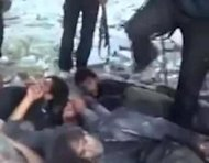 "An image taken from a video dated November 1, uploaded on YouTube, appears to show Syrian soldiers being kicked before being executed by rebel fighters at a checkpoint near Saraqeb. The video ""very likely"" shows a war crime, the UN human rights body said"
