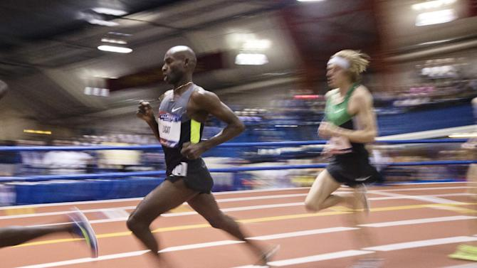 Bernard Lagat, left, competes in the Men's 2-mile event during the 106th Millrose Games Saturday, Feb. 16, 2013, in New York. Lagat won the event with a time of 8:09.49. (AP Photo/Frank Franklin II)