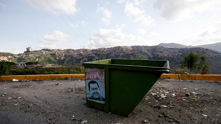In this Jan. 22, 2013 photo, a poster of Venezuela's President Hugo Chavez covers the side of a trash container on the outskirts of Caracas, Venezuela. The cult of personality that Chavez long nurtured has been flourishing like never before as he confronts an increasingly difficult struggle against the mysterious cancer that afflicts him. (AP Photo/Fernando Llano)