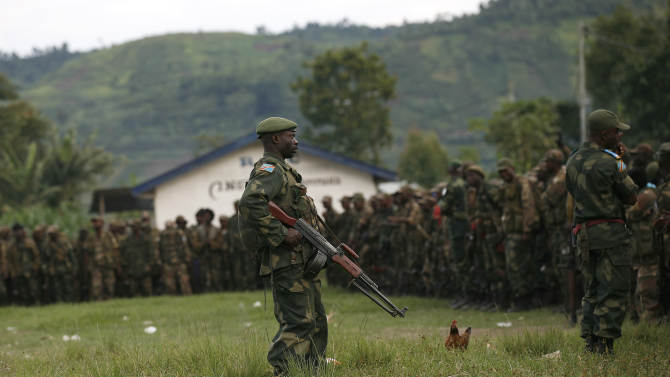 FARDC Congolese government special forces gather in a stadium  near Minova, Congo, some 40 kms south-west of Goma, Thursday Nov. 29, 2012, for a moral building gathering and an address by their commander General Bahouma .M23 Rebels, who last week seized one of the most important cities in eastern Congo and advanced beyond, said Thursday that they had pulled back several miles (kilometers ) to the town of Sake and were on track to leave the key city of Goma by Friday, in accordance with a deadline imposed by the international community. Government troops were massing in Minova.(AP Photo/Jerome Delay)