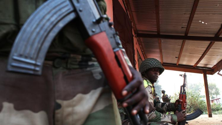 Africa Union peacekeeping soldiers take strategic positions to quell street violence in Bangui