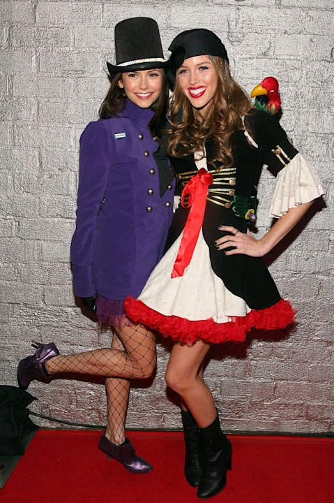 Nina Dobrev and Kayla Ewell arrive at Heidi Klum's 10th Annual Halloween Party  on October 31, 2009 in Los Angeles, California.
