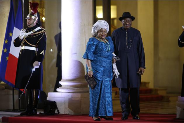 Nigeria's President Goodluck Jonathan and his wife Patience arrive for a dinner with the French President and other dignitaries as part of the Summit for Peace and Security in Africa at the Elysee