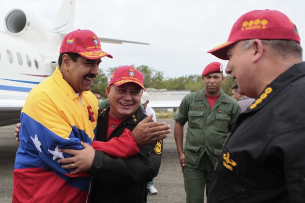 Venezuela's President Maduro embraces National Assembly President Cabello in La Orchila