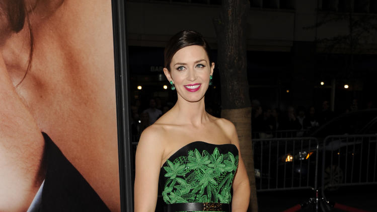 "Actress Emily Blunt attends the Tribeca Film Festival opening night premiere of ""The Five-Year Engagement"" at the Ziegfeld Theatre on Wednesday, April 18, 2012 in New York. (AP Photo/Evan Agostini)"