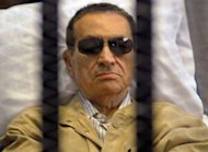 Ousted Egyptian president Hosni Mubarak sits inside a cage in a courtroom during his verdict hearing in Cairo on June 2, 2012. Toppled president Hosni Mubarak, awaiting trial over his role in the deaths of protesters, believes Egyptians should rally around his Islamist successor and end violent protests, his lawyer told AFP on Monday.