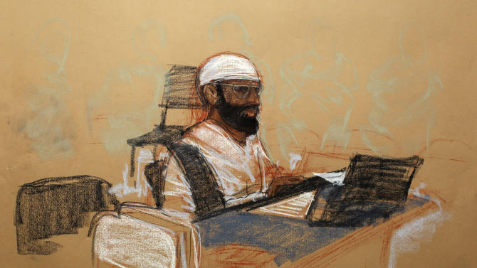 In this photo of a sketch by courtroom artist Janet Hamlin and reviewed by the U.S. Department of Defense, accused Sept. 11 co-defendent Mustafa Ahmed Adam al Hawsawi is shown while attending his military hearing at the Guantanamo Bay U.S. Naval Base in Cuba, Saturday May 5, 2012. Khalid Sheikh Mohammed, the self-proclaimed mastermind of the Sept. 11 attacks repeatedly declined to respond to a judge's questions Saturday, and co-defendant Walid bin Attash was briefly restrained at a military hearing as five men, including al Hawsawi, charged with the worst terror attack in U.S. history appeared in public for the first time in more than three years. (AP Photo/Janet Hamlin, Pool)