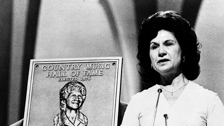 "FILE - This 1976 file photo shows Country Music Hall of Fame inductee Kitty Wells during the Country Music Association (CMA) awards in Nashville, Tenn. Wells, the first female superstar of country music, has died at the age of 92. The singer's family says Wells died at her home Monday after complications from a stroke. Her recording of ""It Wasn't God Who Made Honky Tonk Angels"" in 1952 was the first No. 1 hit by a woman soloist on the country music charts. Other hits included ""Making Believe"" and a version of ""I Can't Stop Loving You.""  (AP Photo, file)"