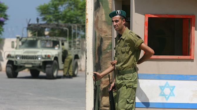 """In this picture taken August 19, 2010, a Lebanese actor playing an Israeli soldier stands at a checkpoint during filming scenes of 33 Days at a film location in Burj Rahal village, southern Lebanon. The film, 33 Days, tells the story of the 2006 war between Israel and the Lebanese militant group Hezbollah in one front-line village and glorifies """"the resistance."""" (AP Photo/Hassan Bahsoun)"""